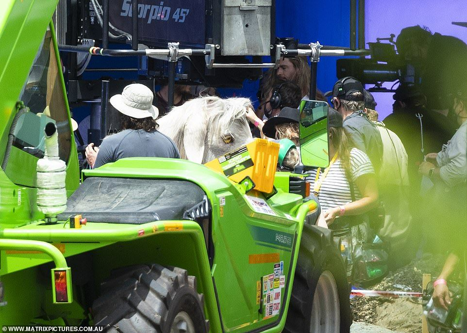 38720704-9209501-Lights_camera_Giving_fans_a_first_glimpse_of_the_new_film_the_Au-a-50_1612180155442