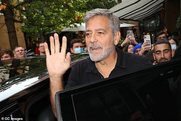 Beaming:The dad-of-two beamed as he was pictured at the coveted event, waving to his doting fans as he made his way onto the red carpet