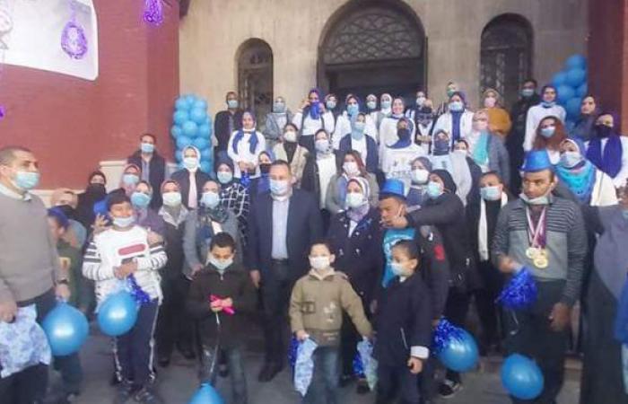 جامعة الإسكندرية تشارك فى وقفة تضامنية مع الأطفال المصابين التوحد