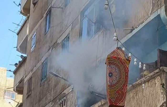 إصابة سيدة وطفليها في حريق شقة بالعجمي | صور
