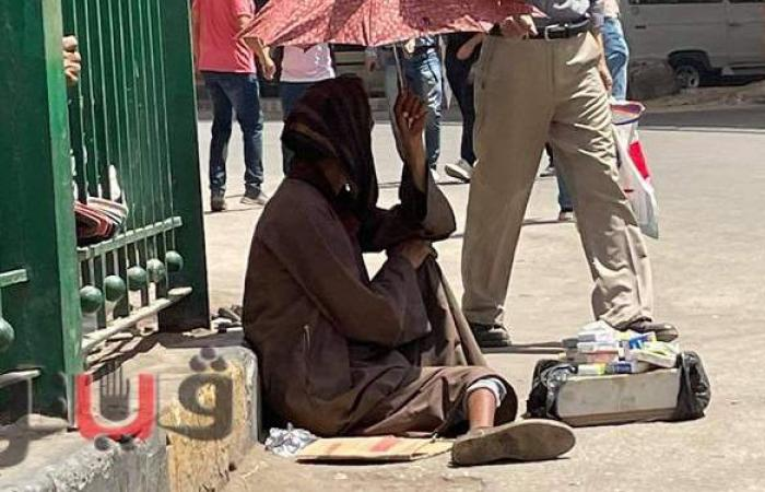 أثر ارتفاع درجات الحرارة على المواطنين بشوارع القاهرة والجيزة | صور